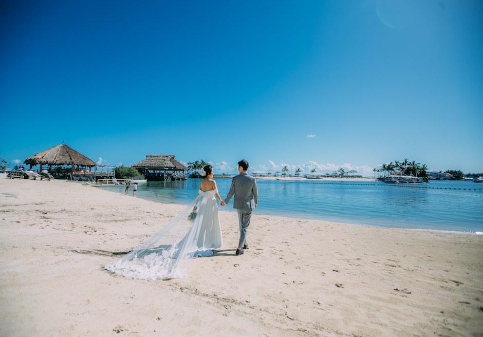 ブルーウォーター・マリバゴ・ビーチリゾート美しい白砂のビーチにてフォトウェディング